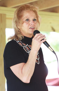 Linda Colvin sings during a competition Saturday afternoon.