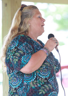 Grace Gordon sings during a competition Saturday afternoon at Old Mill Days.