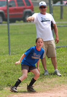 Maggie Overstreet keeps an eye on the action after rounding third base.