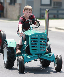 Dallas Kirkland drives a tractor that was just his size.