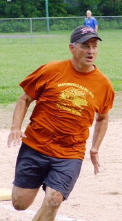 Troy Overstreet rounds third during the old timers softball game.