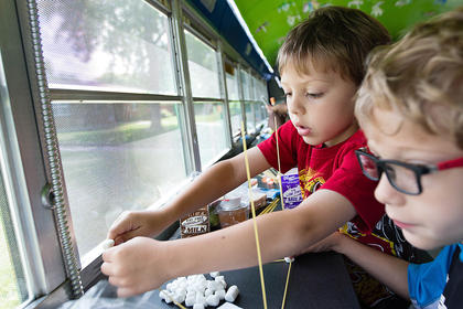 Zach Holliday and JosephJeffries work together to engineer their tower of power out ofmarshmallows and spaghetti noodles on The Dream Bus.