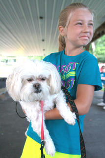 Gracie Benningfield, 8, holds Pookie as they wait for the results of the pet contest Friday at Old Mill Days.