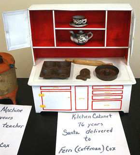 A display of old toys included a 76-year-old toy kitchen cabinet that Santa brought to Fern Cox.