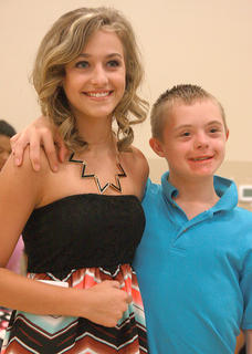 Gretchen Walston, 12, poses for a photo with Hunter Delk, 14, before the beauty contest begins.