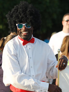 """Tyrone Burton was dressed to impress with his team from Spring View Hospital, which had lots of fun with their """"Big 80's prom"""" theme."""