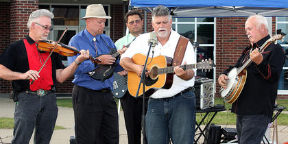 The Honeysuckle Stringband performed the National Anthem and also entertained the crowd at Relay for Life Friday evening.