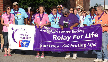 Amy Thomas, Nicole Thompson, Joyce Flowers and Mike Edberg had the honor of holding the Relay for Life banner and leading the survivors' lap.