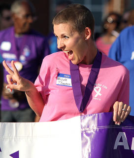 Nicole Cambron Thompson shows her silly side while walking the survivors' lap.
