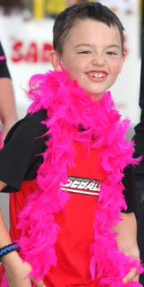Jake Medley gets into the Relay for Life spirit, wearing a bright pink boa.