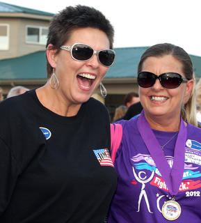 Julie Robey and her sister, Nancy Thompson Leigh, share a big laugh during the care-givers' lap.