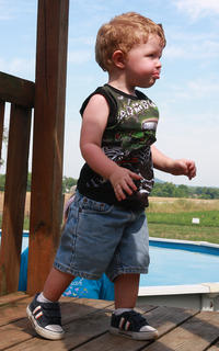 J.T. Gootee, 18 months, climbs on some playground equipment.