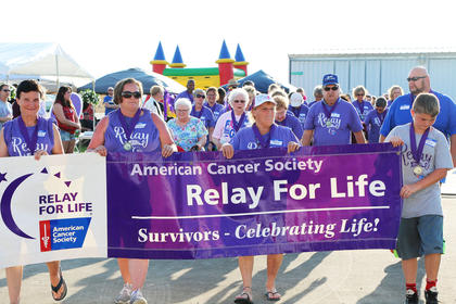 Survivors take their lap during Marion County/Washington County Relay for Life.