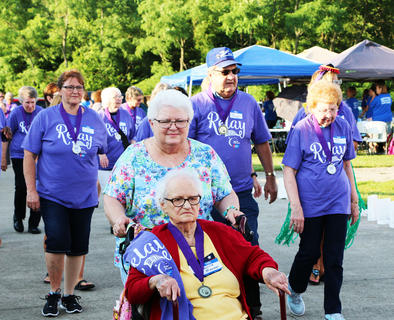 Survivors Pauline Mouser (being pushed by her daughter Carrol Nally), Dianne Mattingly, Pat Maupin and Helen Maupin lead the way during their survivors' lap.