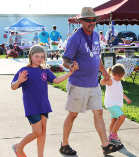 Joe Lamkin and buddies take a lap together during the Relay for Life ceremonies.