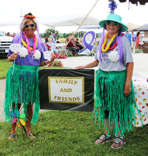 Cathy Carrico and Helen McNeal of Springfield pose beside their friends and family tent, where they hosted silent auction items and a disc golf game.
