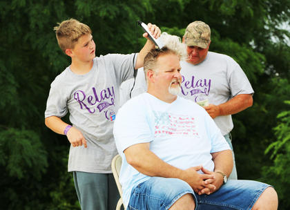 Ray Hamilton of Springfield volunteered his hair to be cut and shaved as part of the auction during the Marion County/Washington County Relay for Life Saturday.