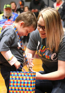 Zachary Baumgardner II, 4, of Loretto admires his medallion with his mother, Carrie Hodge.