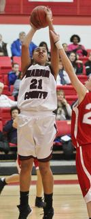 Alexus Calhoun puts two points in during the Lady Knights 65-26 win over Taylor County in the 20th district tournament.