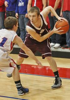 Chase Lancaster looks for an open teammate in the Knights game against Adair County.