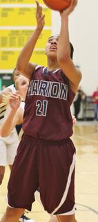 Alexus Calhoun puts in two of her nine points in Marion County's 65-43 win over Elizabethtown to advance to the regional finals.