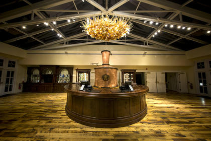 This amber and new oak chandelier greets people in the visitor's center.