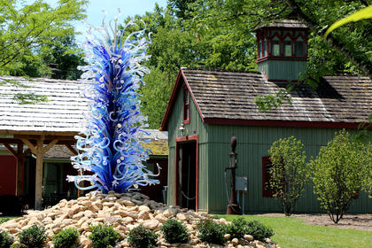 The Waterdrop Tower, which stands at 12-feet, is a classic demonstration of Chihuly's desire to mass color on a steel armature for dramatic effect. For centuries, blown glass pieces were small, intricately designed and admired from atop a table. In contrast, Chihuly's towers rise from the ground like huge stalagmites and have been an iconic aesthetic of installations in art museums and botanical gardens worldwide.