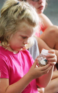 Caroline Blandford examines The Rock Lady's memory jar.