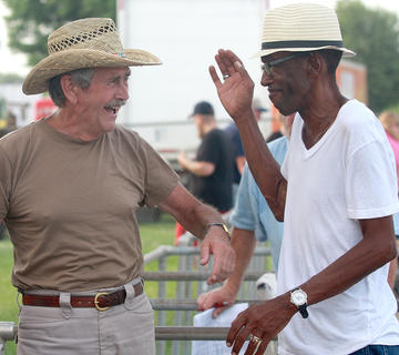 Tom Shehan, left, and David Thompson joke around between horse races July 1 at the Marion County Fair.