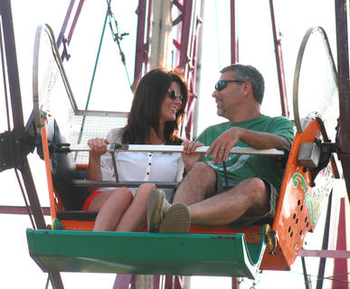 Kim and Chad Hood take a ride on the Ferris wheel July 2 at the Marion County Fair.