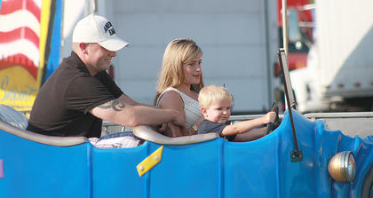 Casen Kemp, 2, drives one of the cars in Jalopy Junction while Weston Kemp and Mercedes Leake go for a ride.