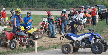 Riders line up for their final practice runs before the KOI Drag Racing begins July 2 at the county fair.
