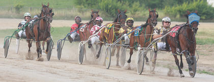 After the first lap, several horses were in contention to win the Coors Light one-mile pace race last week at the fair.