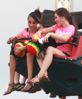 Talena Brown (15), left, and Audrey Hague (13) wait to ride the Superman July 1 at the fair.