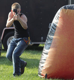Braven Moore fires away during a laser tag game.