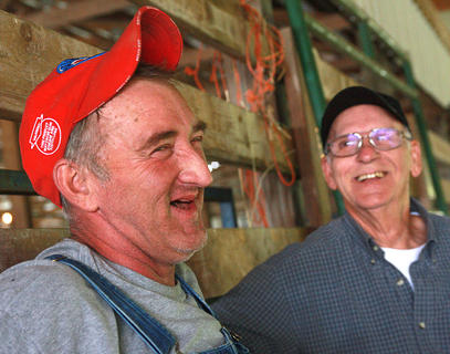 Randy Montgomery of Calvary shares a laugh with Jackie Wicker while waiting for the mule pull to begin.