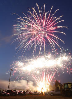 """Fire filled the sky before the final heat at the demolition derby. Attendees of the fair were delighted by the fireworks show. These were far from sparklers and snakes, and people cheered at the """"rocket's red glare."""""""