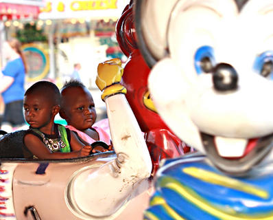 Tyleek Hayden, 2, and Niveayia Porter, 2, both of Lebanon go for a ride with cars modeled after cartoon characters.