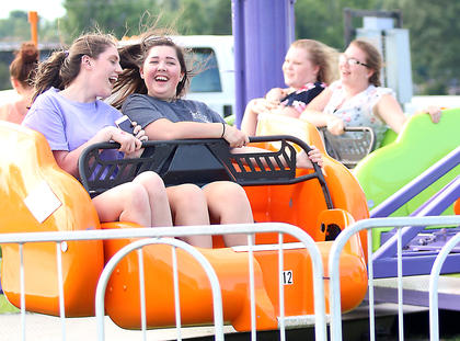 Alexis Deering (left) and Cheyenne Colvin show their excitement on a ride at the Marion County Fair July 3.