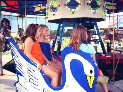 Marisha Mitchell and her friend Taylor Coulter enjoying the rides at the fair.