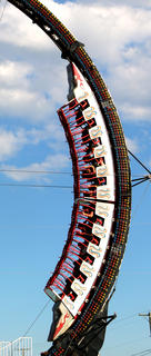 Riders make a descent on the Ring of Fire ride at the fair on Saturday.