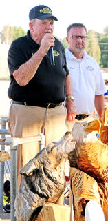 Earl Sandusky auctions off glass items and wood carvings at the Marion County Fair on Saturday.