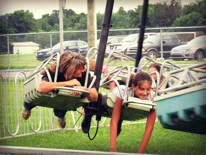 Nora Mitchell got her grandmother Brenda Orberson to ride on the Space Sled with her at the Marion County Fair. They had a wonderful time together. Photo taken by : Lisha Mitchell