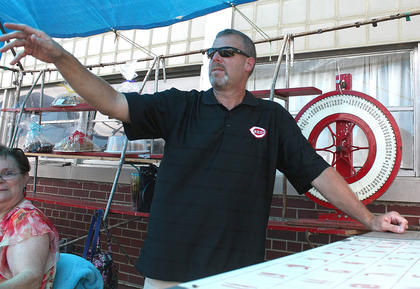 Joe Riggs calls out a number as he works the cake booth.