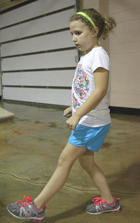 Kaileigh Ervin learns some new steps from the Marion County Cloggers during the Marion County Arts and Humanities Council's art camp. The camp was held last week at the Marion County Extension Office and Lebanon Elementary School.