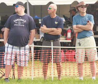 From left, Daniel, Dennis and Dale Kleinheider of St. Louis, Mo., watch planes in flight. They rode their motorcycles to the Lebanon-Springfield Airport to take in the model jet show.