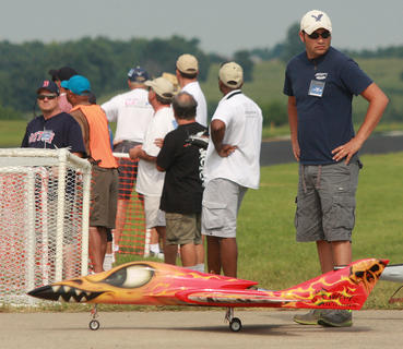 Joseph Kouzez of McAllen, Texas, waits to take one of the more colorful sport jets at the show out for a flight. The jet belongs to James Smith of Fort Worth, Texas.