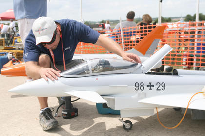 Joel Westrich of Cincinnati puts the cockpit back in place as he prepares to take his Euroflight Typhoon for a flight.