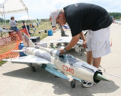 Randy Clark of Miami, Fla., checks on one of his planes in between flights.