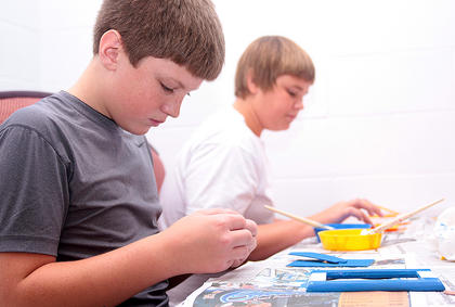 Henry Hagan, 11, left, and Stephen Barlow, 13, finish creating frames.